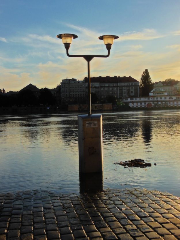 Flooded light pilar by Vltava at Sunset